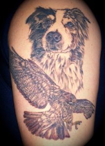 Dog and red-tailed hawk tattoo
