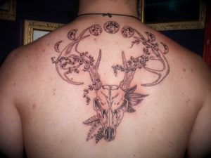 Deer skull and moon phases tattoo